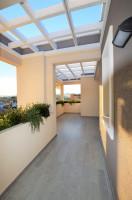attico in vendita Olbia foto 023__immobiliare_brili_attico_via_bellini_veranda_22.jpg